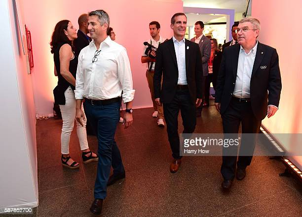 International Olympic Committe President Thomas Bach watches Mayor of Los Angeles Eric Garcetti and Chairman of the LA 2024 Casey Wasserman make...