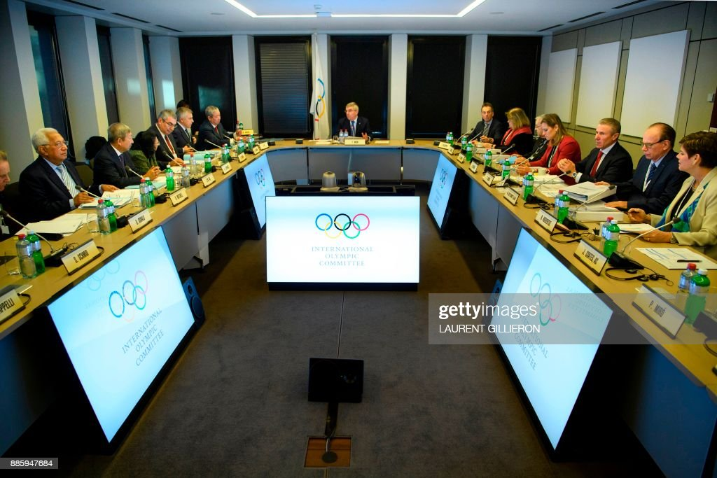 International Olympic Committee (IOC) executive board members listen to president Thomas Bach (C) from Germany, speaking prior to the opening of the first day of the executive board meeting of the International Olympic Committee (IOC) at the IOC headquarters, in Pully near Lausanne, on December 5, 2017. The International Olympic Committee meets to decide whether to bar Russia from the 2018 Winter Olympics for doping violations, in one of the weightiest decisions ever faced by the Olympic movement. /
