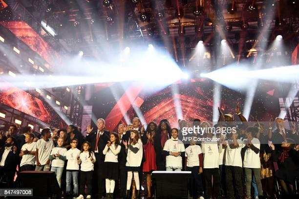 International Olympic Committee member Guy Drut copresident of Paris 2024 Bernard Lapasset president of the Regional Council of the Ile de France...