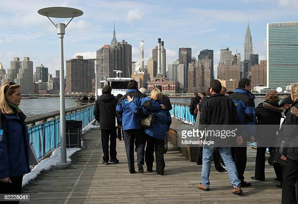 International Olympic Committee members walk to a ferry on the Long Island City waterfront during a tour of proposed Olympic sites February 22 2005...