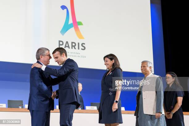 International Olympic Committee President Germany's Thomas Bach greets French President Emmanuel Macron Mayor of Paris Anne Hidalgo Bangladeshi...