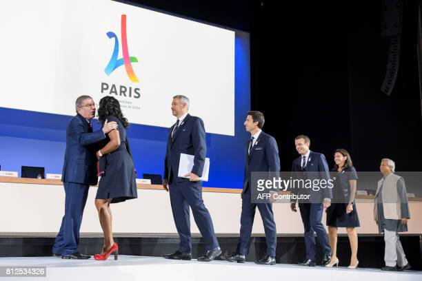 International Olympic Committee President Germany's Thomas Bach greets French Sports Minister Laura Flessel followed by Paris 2024 Olympic bid...