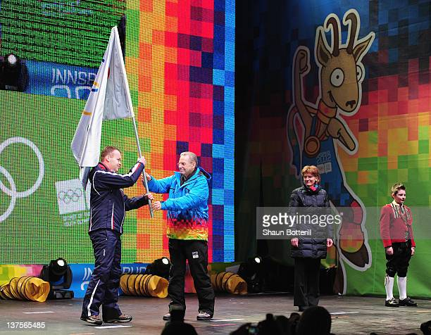 International Olympic Committee President Jacques Rogge passes the Olympic Flag to Lillehammer Mayor Espen Granberg Johnsen during the Closing...