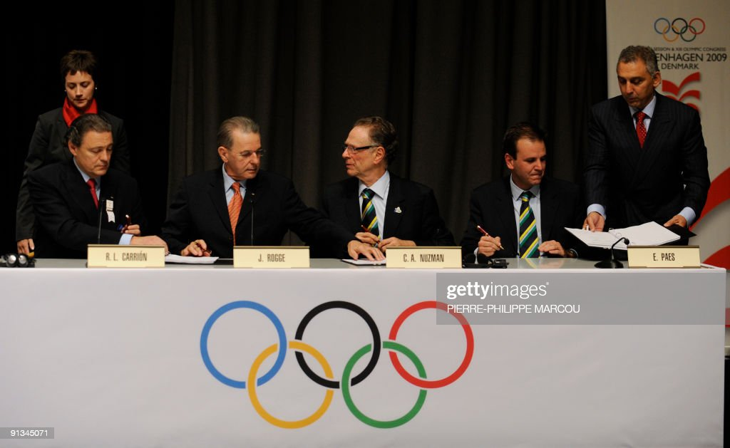 International Olympic Committee (IOC) President Jacques Rogge, Rio de Janeiro 2016 President Carlos Nuzman and Rio Mayor Eduardo Paes rejoice after signing the host city contract after Rio de Janiero was announced as the winning bid for the 2016 Olympic games, on October 2, 2009 in Copenhagen. The International Olympic Committee (IOC) voted in Rio as the 2016 Summer Olympic city today after a final round battle in Copenhagen.