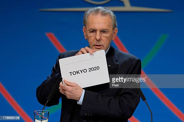 International Olympic Committee President Jacques Rogge shows the name of the city of Tokyo elected to host the 2020 Summer Olympics during a session...
