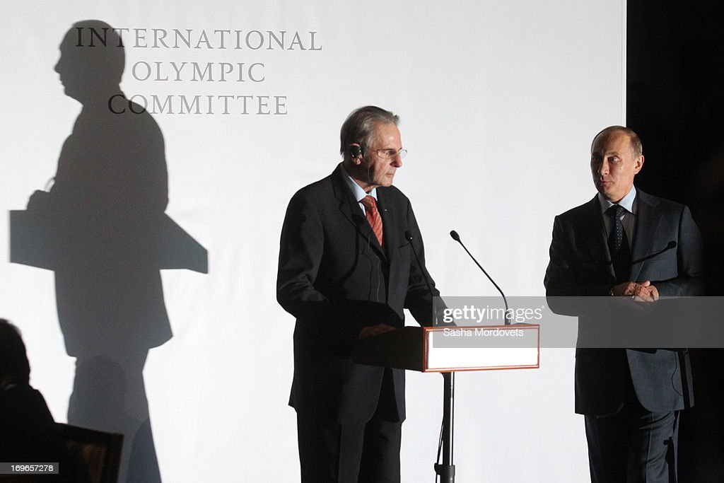 International Olympic Committee (IOC) President <a gi-track='captionPersonalityLinkClicked' href=/galleries/search?phrase=Jacques+Rogge&family=editorial&specificpeople=206143 ng-click='$event.stopPropagation()'>Jacques Rogge</a> (L) speaks as Russian President <a gi-track='captionPersonalityLinkClicked' href=/galleries/search?phrase=Vladimir+Putin&family=editorial&specificpeople=154896 ng-click='$event.stopPropagation()'>Vladimir Putin</a> listens during a presentation of the medals that will be awarded at the 2014 Winter Olympics in Sochi May 30, 2013 in Saint Petersburg, Russia. Putin also voiced his support for the inclusion in the Olympics of wrestling, which the IOC removed for the 2020 games.