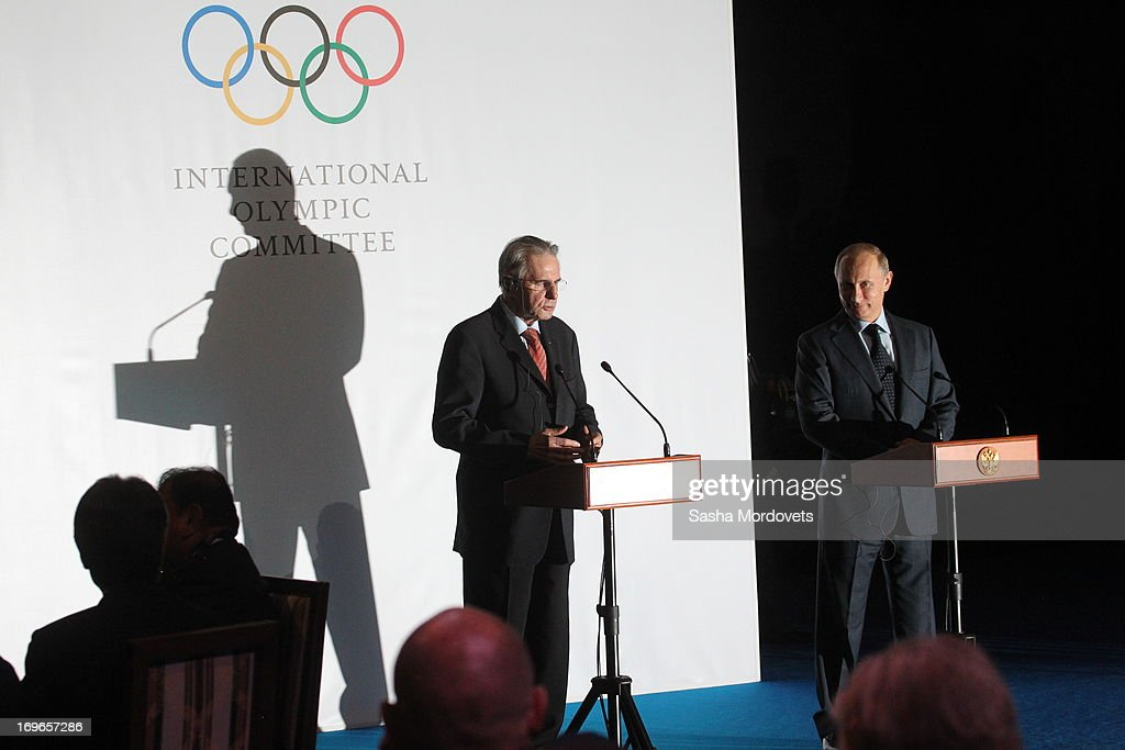 International Olympic Committee (IOC) President Jacques Rogge (L) speaks as Russian President Vladimir Putin listens during a presentation of the medals that will be awarded at the 2014 Winter Olympics in Sochi May 30, 2013 in Saint Petersburg, Russia. Putin also voiced his support for the inclusion in the Olympics of wrestling, which the IOC removed for the 2020 games.
