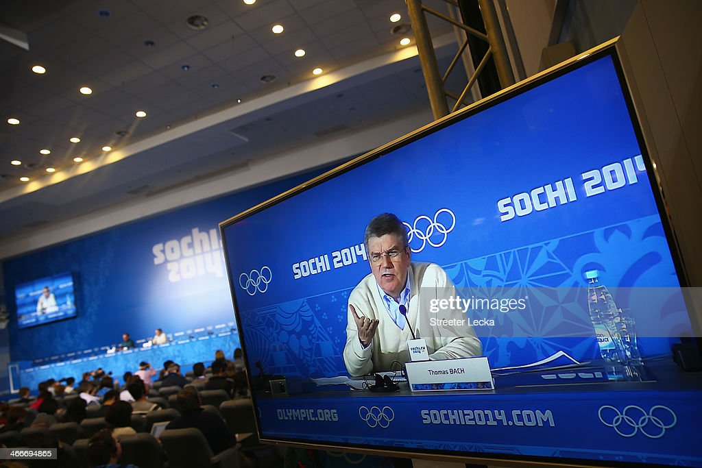 International Olympic Committee President Thomas Bach appears on screen as he attends a press conference ahead of the Sochi 2014 Winter Olympics at...
