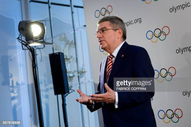 International Olympic Committee president Thomas Bach gestures during a press conference following an IOC executive meeting in Lausanne on June 3...