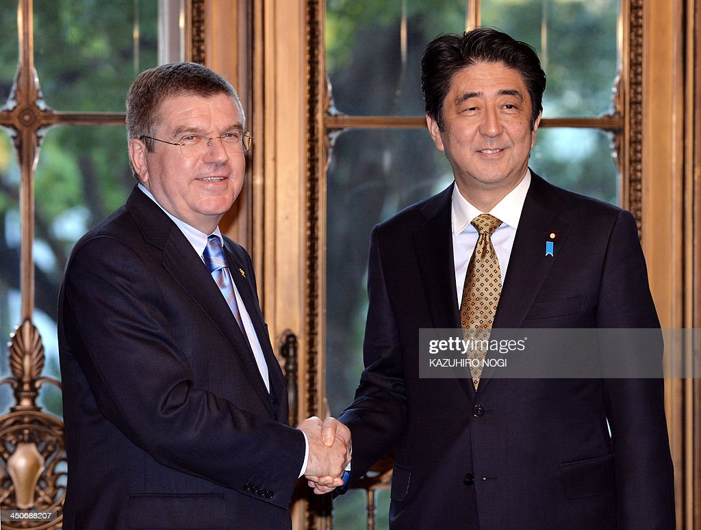 International Olympic Committee President Thomas Bach (L) is greeted by Japanese Prime Minister Shinzo Abe at the Diet in Tokyo on November 20, 2013. The International Olympic Committee will discuss a proposal by Japan and other countries to reinstate baseball and softball in the 2020 Olympics in Tokyo, its new chief Bach said on November 20.