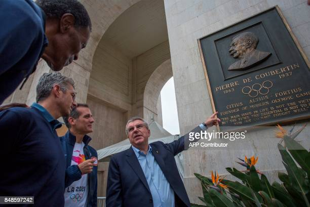 International Olympic Committee President Thomas Bach points to a plaque of Pierre de Coubertin the founder of modern Olympic games for Olympic Gold...