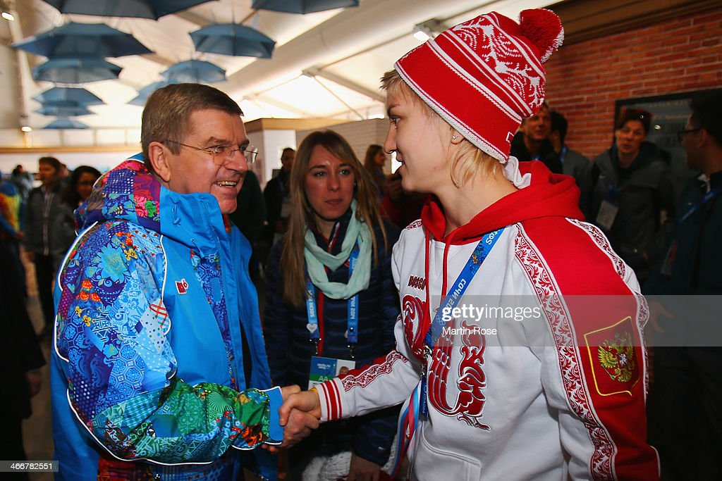 International Olympic Committee (IOC) President Thomas Bach (L) shakes hands with ice hockey player Iya Gavrilova in the Coastal Cluster athletes' village ahead of the Sochi 2014 Winter Olympics at the Athletes Olympic Village on February 4, 2014 in Sochi, Russia.