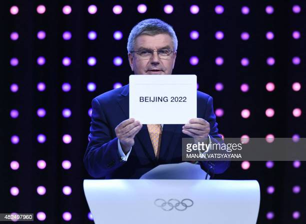 International Olympic Committee president Thomas Bach shows the card with the name Beijing as the winning name of the 2022 Winter Olympic bid city...