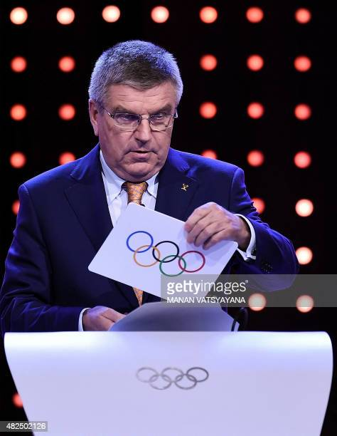 International Olympic Committee president Thomas Bach takes out the card with the name Beijing as the winning name of the 2022 Winter Olympic bid...