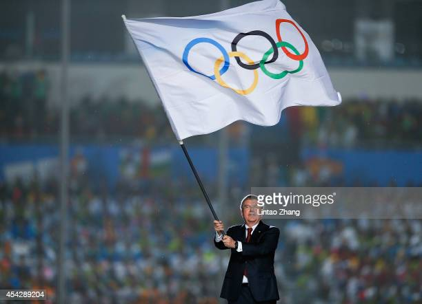 International Olympic Committee President Thomas Bach waves the Olympic flag during the Closing Ceremony of Nanjing 2014 Summer Youth Olympic Games...