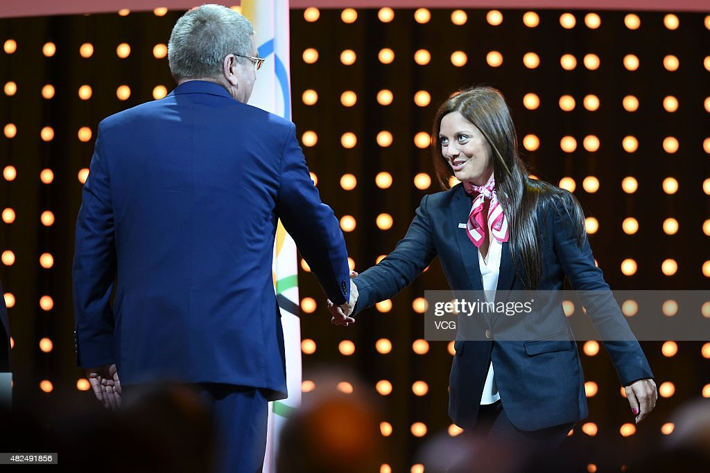 International Olympic Committee (IOC) president <a gi-track='captionPersonalityLinkClicked' href=/galleries/search?phrase=Thomas+Bach&family=editorial&specificpeople=610149 ng-click='$event.stopPropagation()'>Thomas Bach</a> (L) welcomes Switzerland's ski champion <a gi-track='captionPersonalityLinkClicked' href=/galleries/search?phrase=Virginie+Faivre&family=editorial&specificpeople=786060 ng-click='$event.stopPropagation()'>Virginie Faivre</a> at the 128th IOC session on July 31, 2015 in Kuala Lumpur, Malaysia.