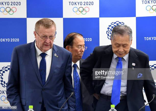 International Olympic Committee vice president John Coates and Tokyo 2020 Olympics president Yoshiro Mori take their seats while Tokyo 2020 CEO...
