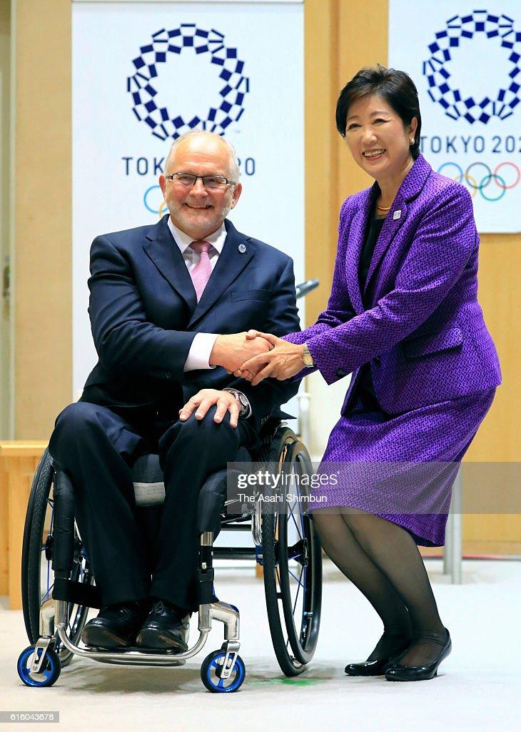 International Paralympic Committee President Philip Craven and Tokyo Metropolitan Governor Yuriko Koike shake hands during their meeting at Tokyo Metropolitan headquarters on October 21, 2016 in Tokyo, Japan.