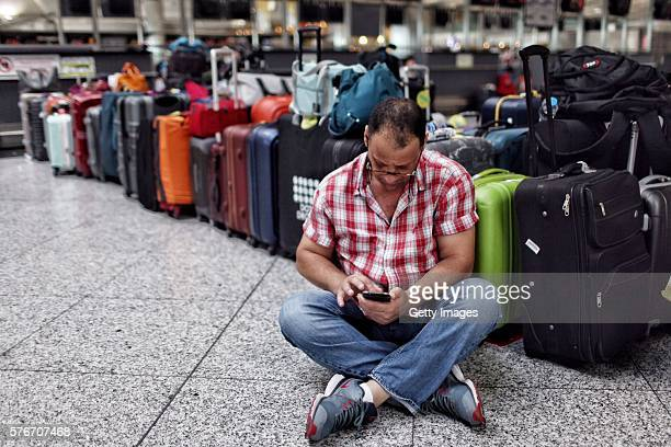 International passengers wait for flight information after flights to Ataturk Airport were delayed or cancelled on July 17 2016 in Istanbul Turkey...