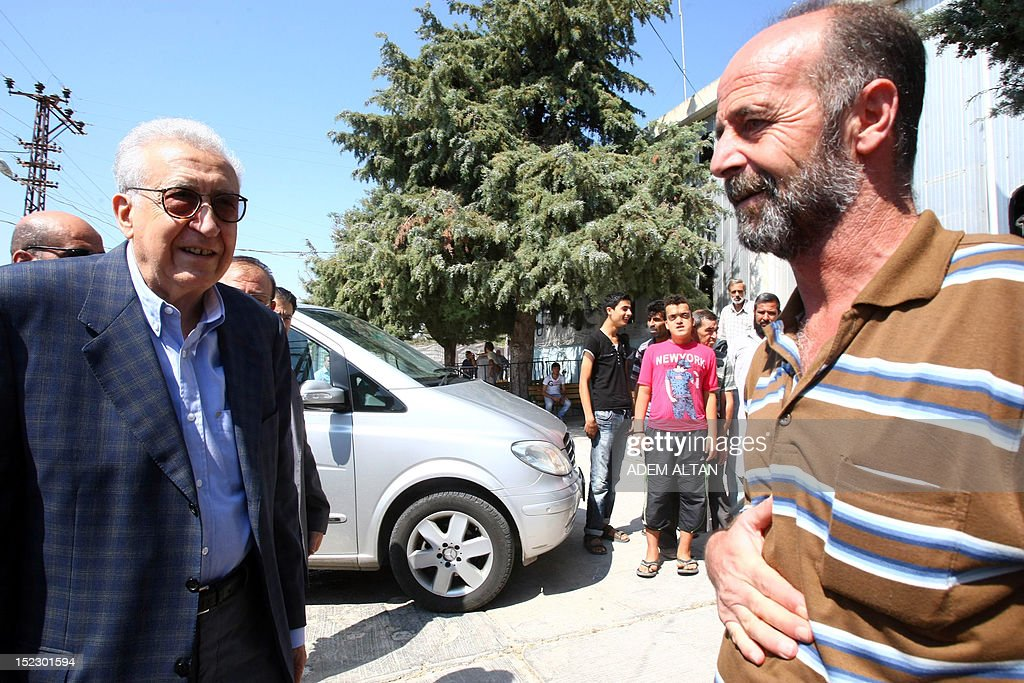 International peace envoy for Syria Lakhdar Brahimi (L) meets with Syrians refugees staying at the Altinozu camp in Hatay city, located on the border with their violence-racked homeland, on September 18, 2012. The Altinozu camp is one of the first refugee camps set up by Turkey soon after the unrest erupted in Syria mid-March 2011, which has already killed 20,000 according to UN figures and forced 250,000 to flee into neighbouring countries.