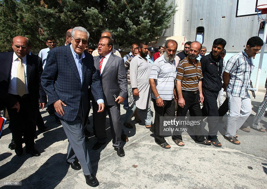 International peace envoy for Syria Lakhdar Brahimi (front, L) visits the Altinozu camp in Hatay city, located on the border with their violence-racked homeland, on September 18, 2012. The Altinozu camp is one of the first refugee camps set up by Turkey soon after the unrest erupted in Syria mid-March 2011, which has already killed 20,000 according to UN figures and forced 250,000 to flee into neighbouring countries. AFP PHOTO / ADEM ALTAN