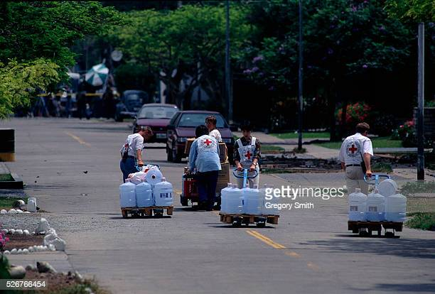 International Red Cross members transport food and water to hostages at the residence of the Japanese ambassador in Lima Peru which has been taken...