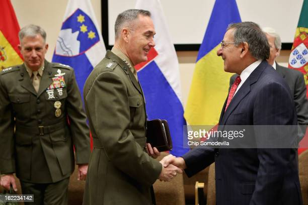 International Security Assistance Force and United States ForcesAfghanistan Commander Gen Joseph Dunford Jr greets US Secretary of Defense Leon...