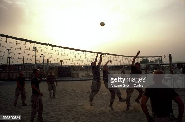 International Security Assistance Force soldiers playing volleyball at the Kandahar military base An estimated 12000 soldiers live on the base