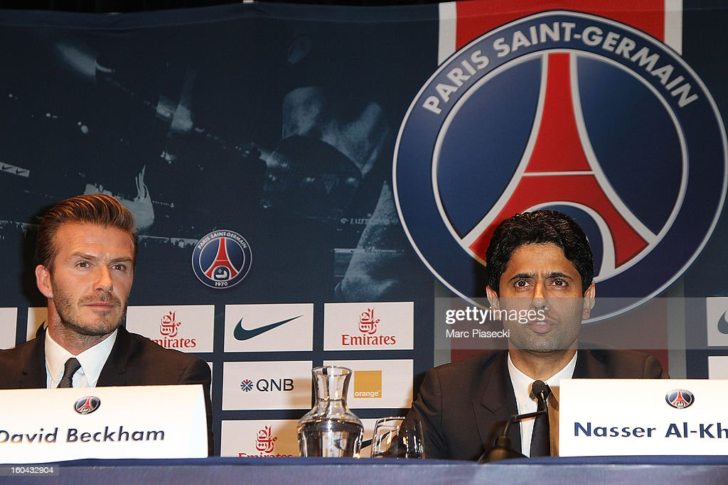 International soccer player David Beckham and Nasser Al-Khelaifi attend the press conference for his PSG signing at Parc des Princes on January 31, 2013 in Paris, France.