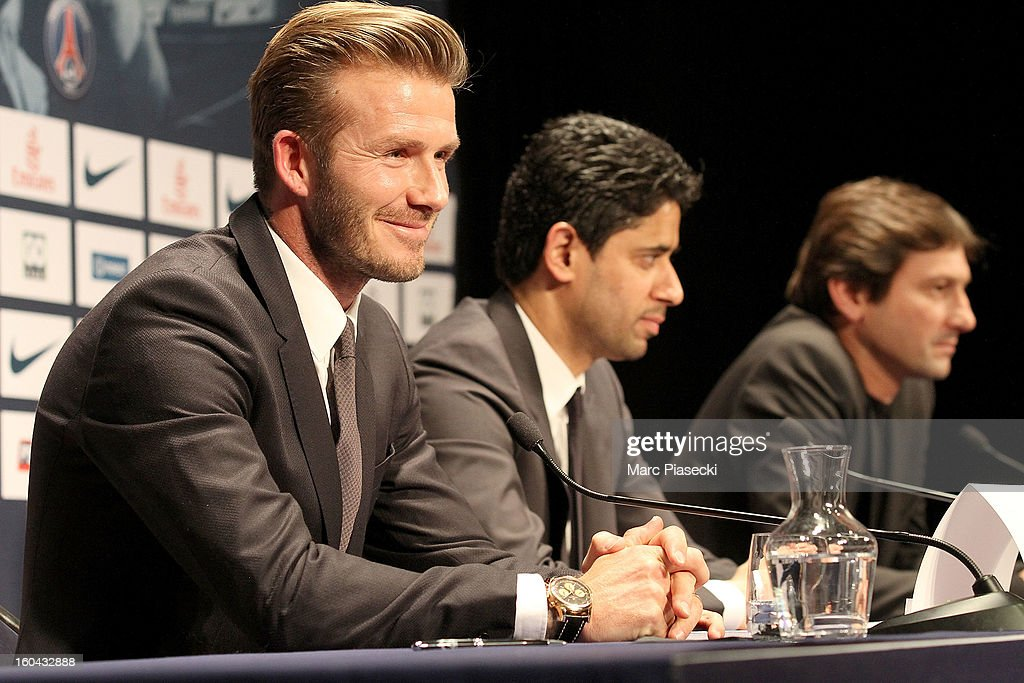 International soccer player <a gi-track='captionPersonalityLinkClicked' href=/galleries/search?phrase=David+Beckham&family=editorial&specificpeople=158480 ng-click='$event.stopPropagation()'>David Beckham</a>, <a gi-track='captionPersonalityLinkClicked' href=/galleries/search?phrase=Nasser+Al-Khelaifi&family=editorial&specificpeople=7941556 ng-click='$event.stopPropagation()'>Nasser Al-Khelaifi</a> and Leonardo attend the PPress conference for his PSG signature at Parc des Princes on January 31, 2013 in Paris, France.