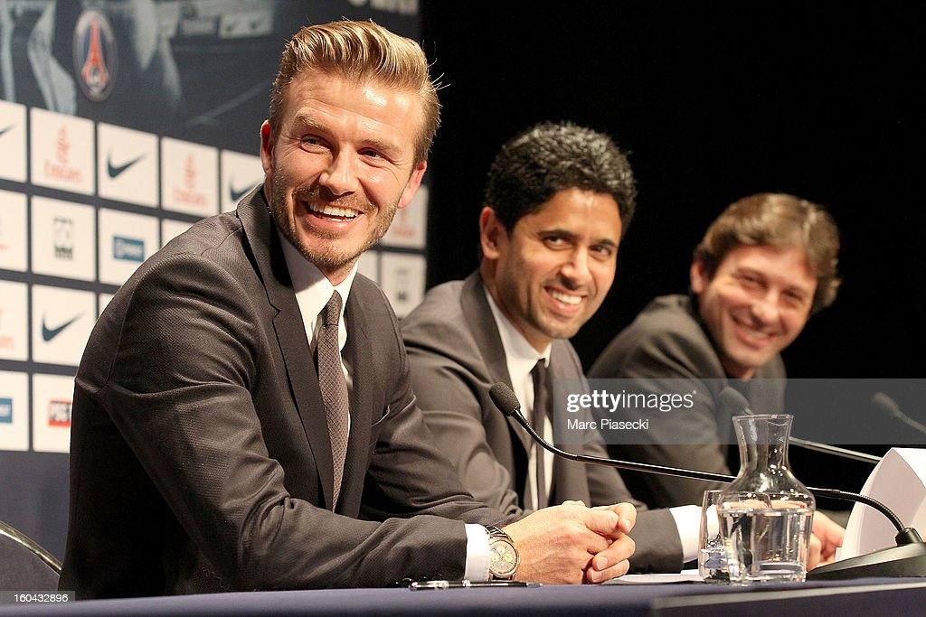 International soccer player <a gi-track='captionPersonalityLinkClicked' href=/galleries/search?phrase=David+Beckham&family=editorial&specificpeople=158480 ng-click='$event.stopPropagation()'>David Beckham</a>, <a gi-track='captionPersonalityLinkClicked' href=/galleries/search?phrase=Nasser+Al-Khelaifi&family=editorial&specificpeople=7941556 ng-click='$event.stopPropagation()'>Nasser Al-Khelaifi</a> and Leonardo attend the press conference for his PSG signing at Parc des Princes on January 31, 2013 in Paris, France.