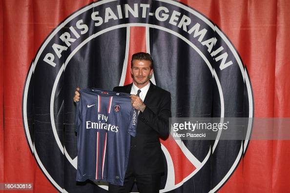 International soccer player David Beckham poses with his PSG Football shirt after his PSG signature at Parc des Princes on January 31 2013 in Paris...