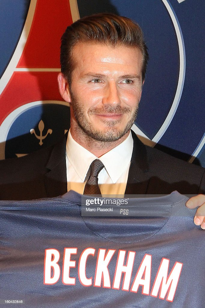 International soccer player <a gi-track='captionPersonalityLinkClicked' href=/galleries/search?phrase=David+Beckham&family=editorial&specificpeople=158480 ng-click='$event.stopPropagation()'>David Beckham</a> poses with his PSG Football shirt after his PSG signing at Parc des Princes on January 31, 2013 in Paris, France.