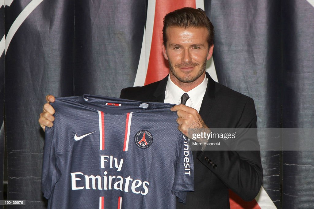 International soccer player <a gi-track='captionPersonalityLinkClicked' href=/galleries/search?phrase=David+Beckham&family=editorial&specificpeople=158480 ng-click='$event.stopPropagation()'>David Beckham</a> poses with his PSG Football shirt after his PSG signature at Parc des Princes on January 31, 2013 in Paris, France.