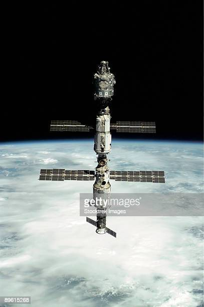 International Space Station backdropped against Earth's horizon.