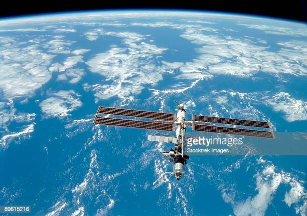 International Space Station backdropped by a blue and white Earth.