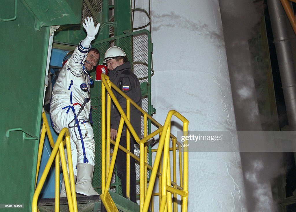 International Space Station crew member Russian cosmonaut Pavel Vinogradov waves as he boards the spacecraft at the Russian-leased Baikonur cosmodrome on March 29, 2013. US astronaut Christopher Cassidy, Russian cosmonauts, Pavel Vinogradov and Alexander Misurkin are set to blast off early on March 29 for the International Space Station (ISS) aboard a Soyuz TMA-08M spacecraft. AFP PHOTO / POOL / SHAMIL ZHUMATOV
