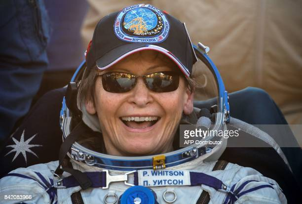 International Space Station crew member US astronaut Peggy Whitson reacts shortly after landing in a remote area outside the town of Dzhezkazgan...