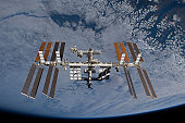 November 25, 2009 - International Space Station set against the background of a cloud covered Earth.