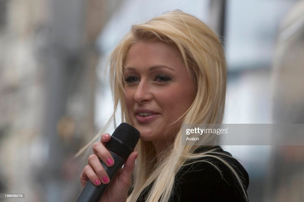 International style icon and heiress <a gi-track='captionPersonalityLinkClicked' href=/galleries/search?phrase=Paris+Hilton&family=editorial&specificpeople=171761 ng-click='$event.stopPropagation()'>Paris Hilton</a> launching her new fragrance 'Heiress' at BT2 , Grafton St, Dublin. Also in attendance were mother Kathy and father Rick, 11th November 2006.