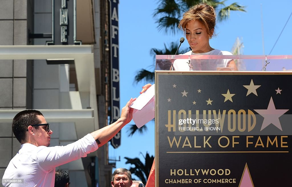 International superstar Jennifer Lopez has her speech handed to her by her partner Casper during the unveilng ceremony of her star in Hollywood...