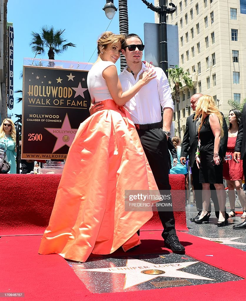 International superstar Jennifer Lopez poses with her partner Casper on her just unveiled star in Hollywood California on June 20 2013 Lopez is the...