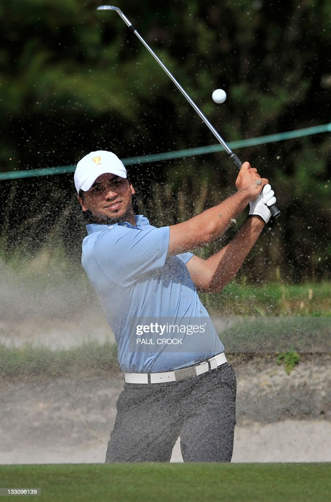 International Team member <a gi-track='captionPersonalityLinkClicked' href=/galleries/search?phrase=Jason+Day+-+Golfer&family=editorial&specificpeople=4534484 ng-click='$event.stopPropagation()'>Jason Day</a> of Australia chips out of a bunker during his President's Cup tournament match played at the Royal Melbourne golf course, in Melbourne on November 17, 2011. A non-European International team, comprising golfers from Australia, South Africa, Japan and South Korea, takes on the US for the President's Cup trophy. EDITORIAL