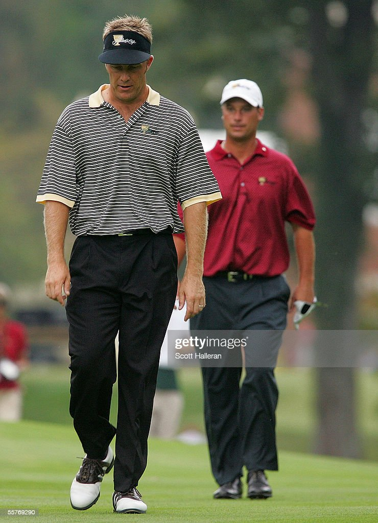 International team member Stuart Appleby walks to the 17th green ahead of Chris DiMarco of the USA during the Sunday Singles Matches at the 2005...