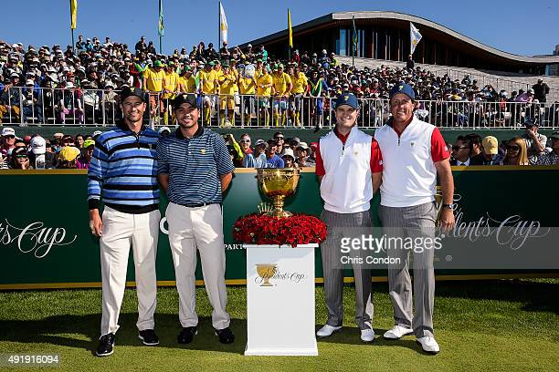 International Team players Adam Scott of Australia and Jason Day of Australia along with Team USA players Zach Johnson and Phil Mickelson pose with...