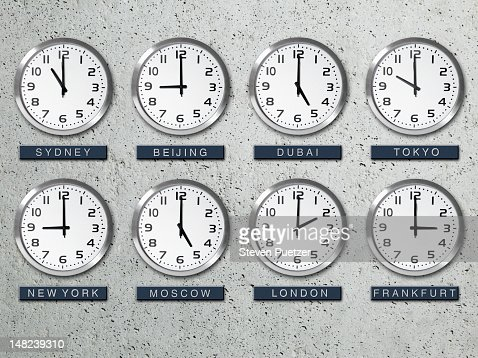International Time Zone Clocks On A Concrete Wall Stock