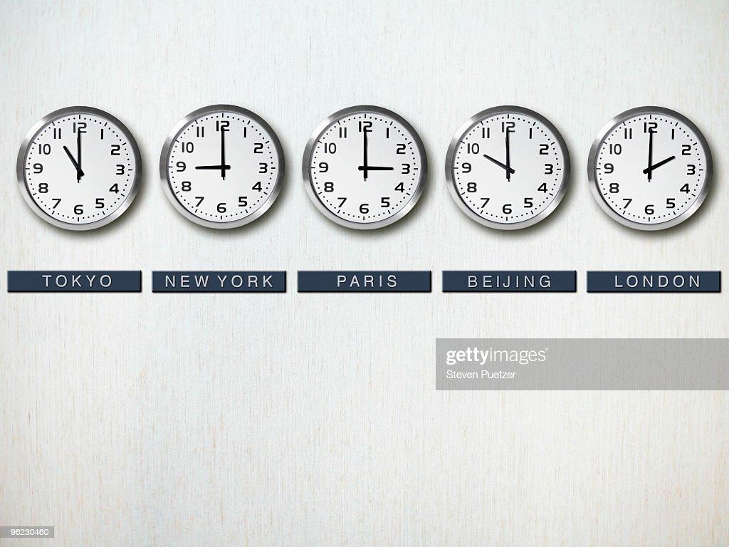 International time zone clocks on wall : Stock Photo