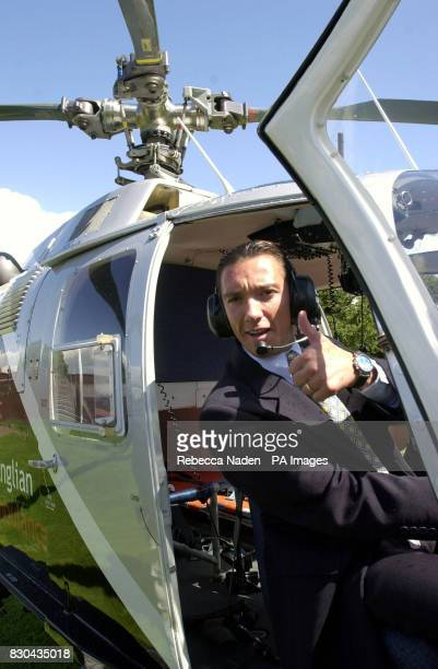 International top jockey Frankie Dettori at the controls of an East Anglican Air Ambulance helicopter at Newmarket racecourse Suffolk to help launch...