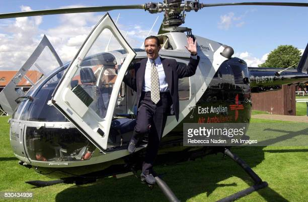 International top jockey Frankie Dettori stands on an East Anglican Air Ambulance helicopter at Newmarket racecourse Suffolk to help launch a 300000...
