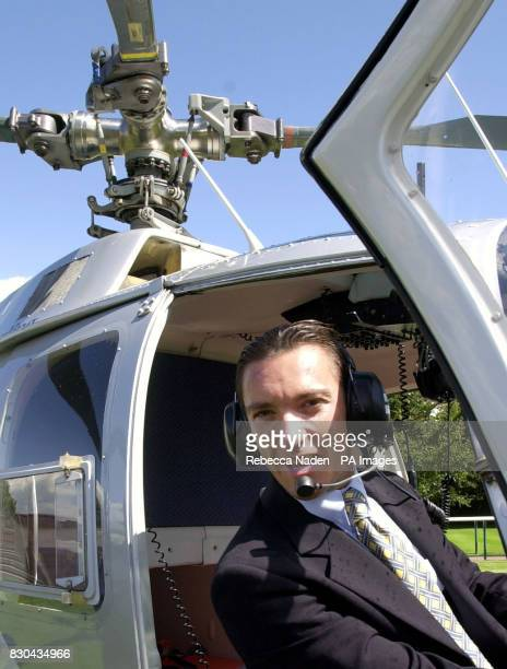 International top jockey Frankie Dettorisits at the controls of an East Anglican Air Ambulance helicopter at Newmarket racecourse Suffolk to help...